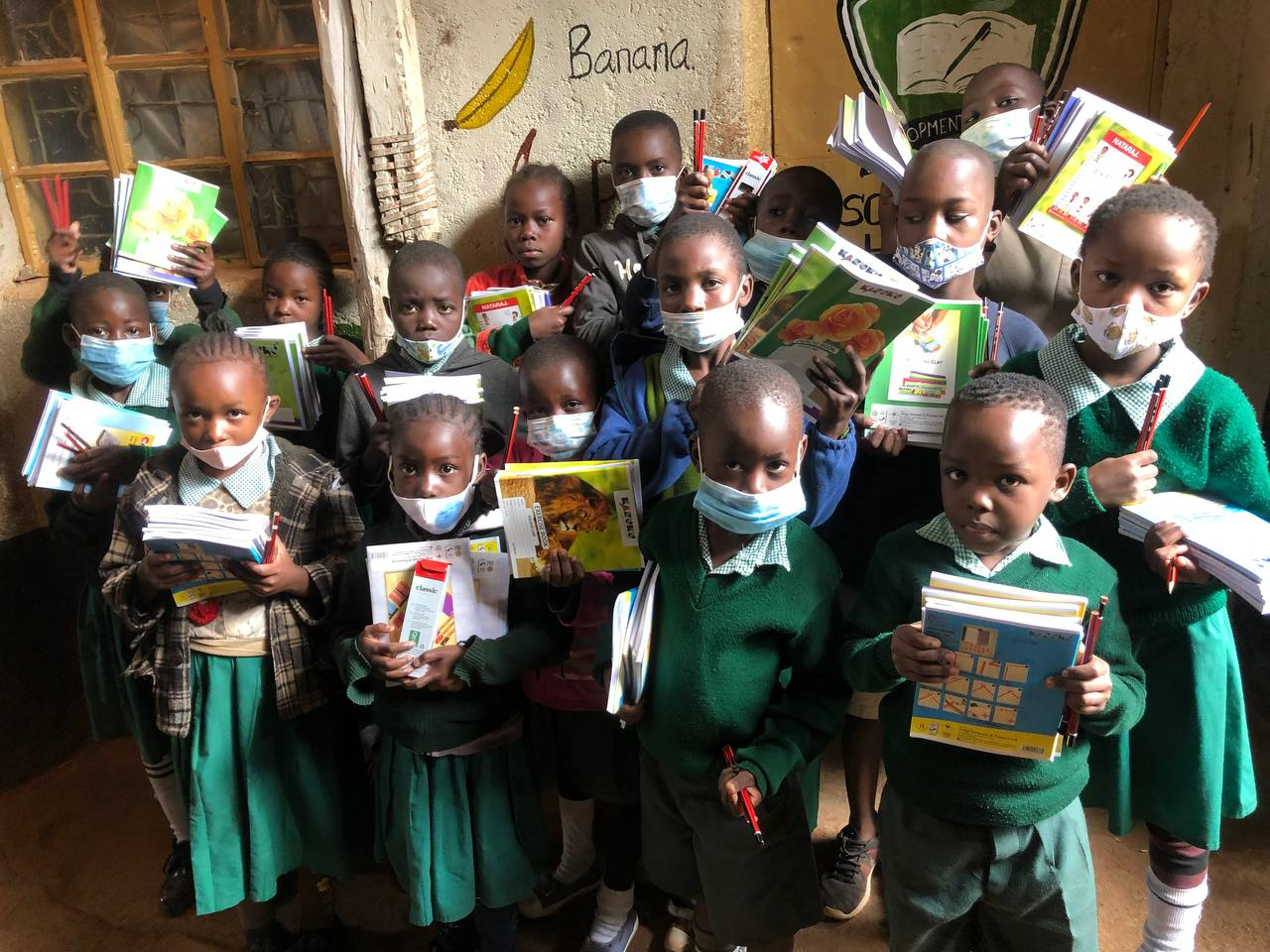 Children in Kibera with school supplies purchased by Chaffinch